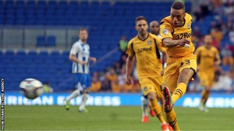 Christian Jolley fires a left-footed shot for Newport County