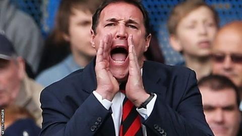 Malky Mackay shouts orders to his players from the touchline