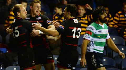 Edinburgh's Greig Tonks celebrates after his try against Treviso