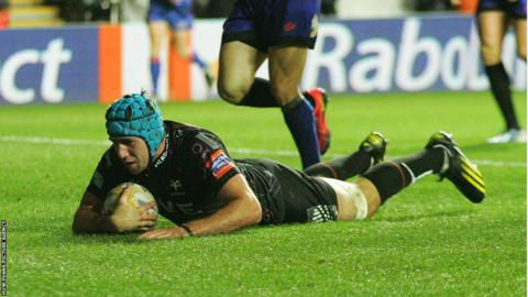 Flanker Justin Tipuric crosses for one of his two tries in the Ospreys 40-17 won over the Dragons in Swansea.