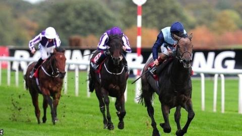 Kingston Hill and Andrea Atzeni (right) race to victory at Doncaster