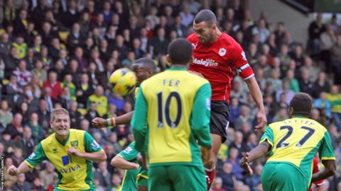 Cardiff City defender Steven Caulker goes close to scoring against Norwich City with a header