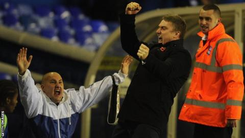 Birmingham manager Lee Clark (centre) celebrates an equaliser against Stoke in the League Cup.