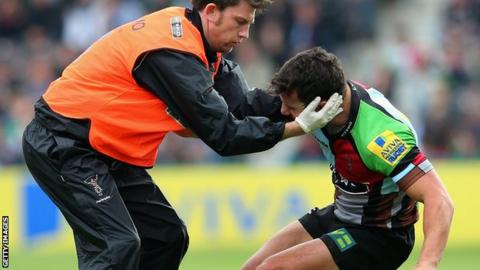 George Lowe is treated for a neck injury