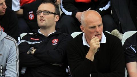 Former Antrim boss Liam Bradley pictured alongside his son Paddy