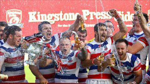 Rochdale celebrate winning the Kingstone Press Championship One grand final in 2013