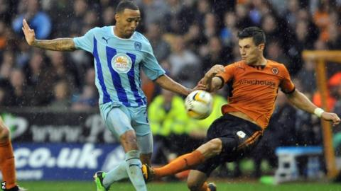 Callum Wilson (left) shoots for Coventry