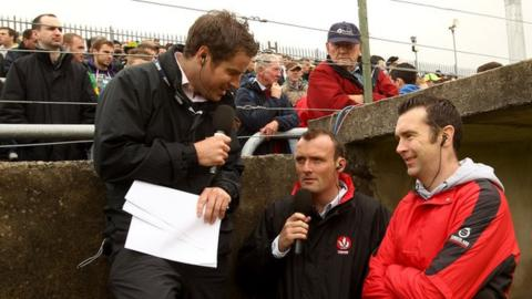 Thomas Niblock with Paddy Bradley and Oisin McConville