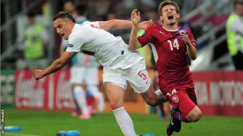 Dariusz Dudka of Poland (right) battles with and Vaclav Pilar of Czech Republic
