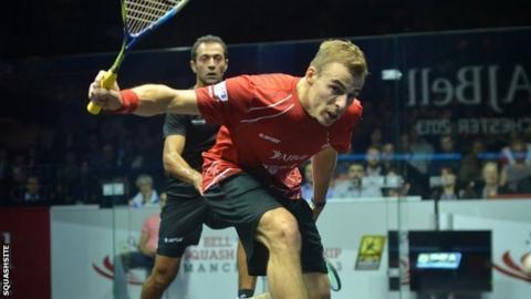 Nick Matthew plays a shot against Amr Shabana
