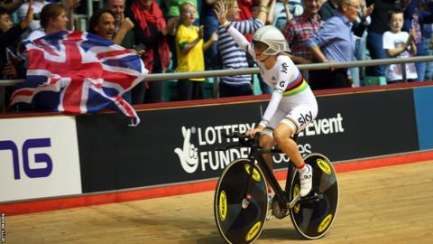 Elinor Barker celebrates after setting a new world record time as Great Britain's women win the team pursuit at the Track Cycling World Cup in Manchester.