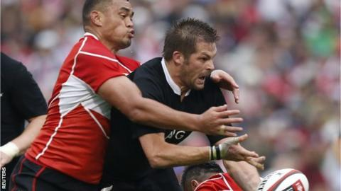 New Zealand captain Richie McCaw is tackled by Japan counterpart Toshiaki Hirose