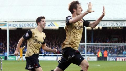 David Mooney (r) celebrates at London Road