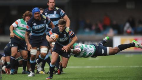 Lewis Jones of Cardiff Blues is tackled by Mano Vosawai of Benetton Treviso
