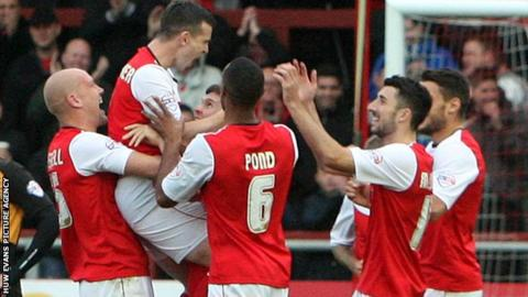 Steve Schumacher celebrates with his team-mates
