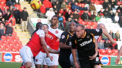 Lee Minshull goes close with a header for Newport at Highbury