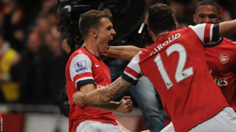 Aaron Ramsey celebrates after his long-range goal, his 10th of the season, seals a 2-0 win for Arsenal against Liverpool