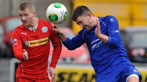 Cliftonville's Martin Murray competes against Cameron Grieve of Dungannon Swifts during the 2-2 draw at Solitude
