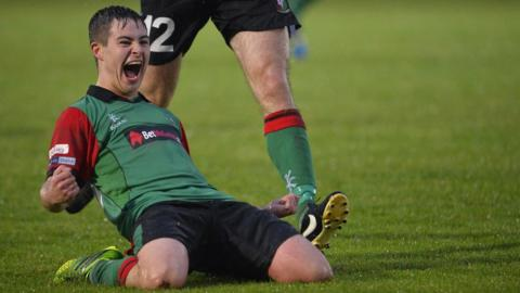 Jordan Stewart of Glentoran celebrates after scoring in his side's 4-3 win away to Ballymena United