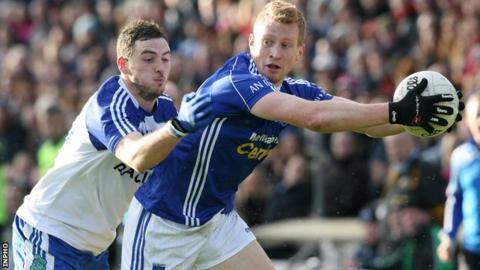 Ballinderry's Daniel McKinless challenges Kieran Hughes of Scotstown