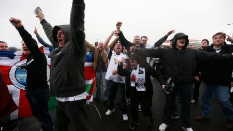 Swansea City fans arrive at Cardiff City Stadium for the much anticipated south Wales derby against the Bluebirds