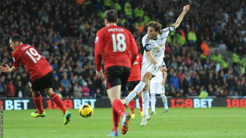 Swansea forward Michu goes closest to breaking the deadlock in a disappointingly subdued first half of the south Wales derby but his shot is well parried by Cardiff goalkeeper David Marshall