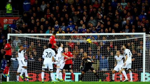 Stephen Caulker rises to head Cardiff into the lead against Swansea from a corner