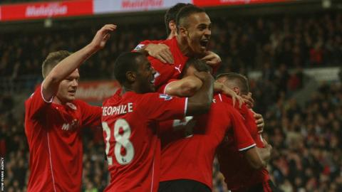 Cardiff players mob Stephen Caulker after his header puts them ahead against Swansea