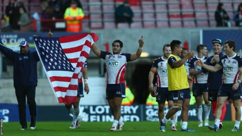 United States players celebrate their victory over Wales with a lap of honour at Wrexham's Racecourse Ground.