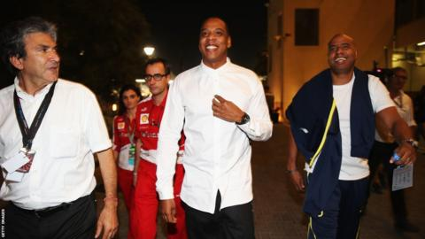 Musician Jay-Z arrives in the F1 paddock following practice for the Abu Dhabi Grand Prix