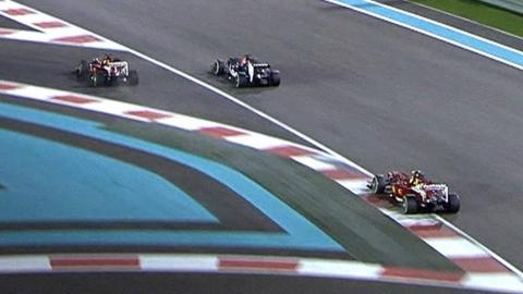 Fernando Alonso crashes over the kerbs in the Abu Dhabi Grand Prix as he battles with Jean-Eric Vergne after exiting the pits.