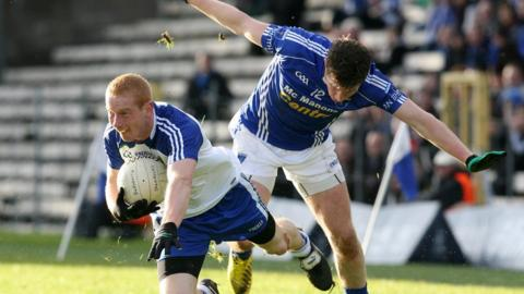 Ballinderry's Conor Nevin takes a tumble after this challenge from Scotstown forward Darren Hughes at Clones