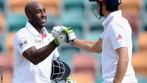 Michael Carberry is congratulated by England captain Alastair Cook