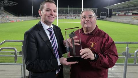 Sam McBurney receives his award from BBC Sport NI's Thomas Kane
