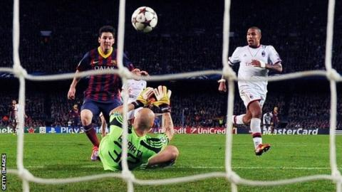 Barcelona's Argentine forward Lionel Messi (left) scores during the Champions League Barcelona v AC Milan
