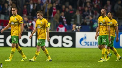 Celtic players look dejected following the 1-0 defeat by Ajax