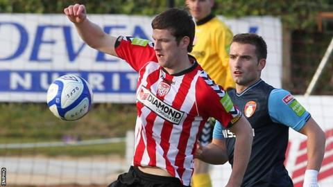 Ryan McBride shields the ball from St Pat's player Christy Fagan
