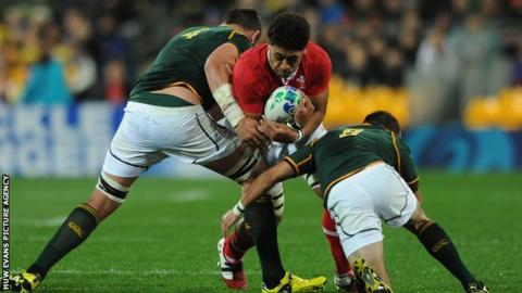 Wales back-row Toby Faletau takes on the South Africa defence in 2011