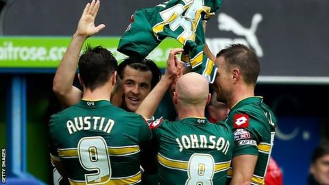 Joey Barton holds up Alejandro Faurlin's shirt as he celebrates his equaliser against Reading