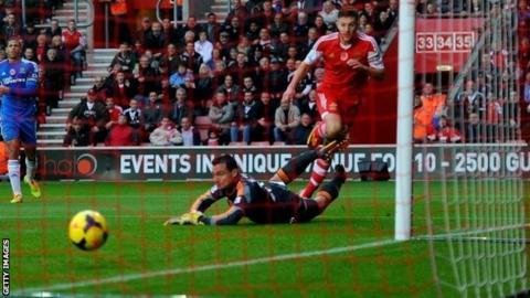 Adam Lallana of Southampton beats Steve Harper of Hull City