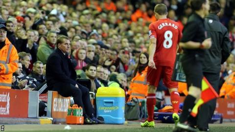 Liverpool captain Steven Gerrard walks off after being substituted by Reds boss Brendan Rodgers