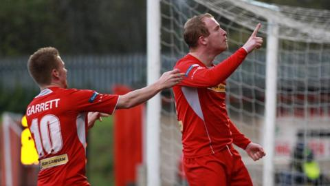 Goalscorers Stephen Garrett and Liam Boyce celebrate Cliftonville's win over Ballymena at Solitude