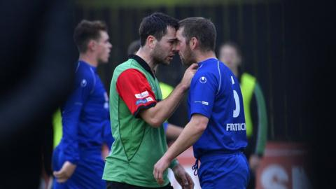 Ryan O'Neill and Terry Fitzpatrick confront each other at Stangmore Park