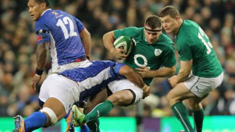 Ireland wing Fergus McFadden is tackled by Samoa's Faatoina Autagavaia in Dublin