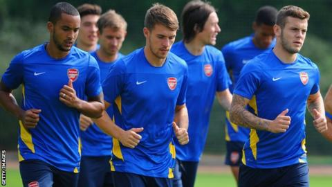 Theo Walcott (left), Aaron Ramsey (centre) and Jack Wilshere