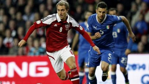 Italy's Thiago Motta, right, and Denmark's Christian Eriksen during the 2014 World Cup Group B qualifying match between Denmark and Italy