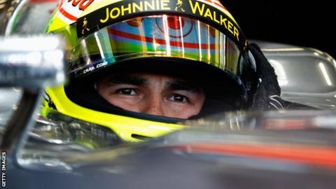McLaren driver Sergio Perez prepares to drive during practice