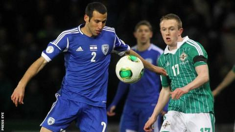 Shane Ferguson (right) in action against Israel in March