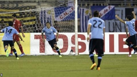 Uruguay celebrate Maxi Pereira's opener