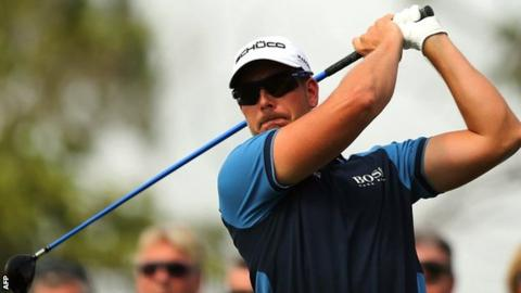 Henrik Stenson in first-round action at the World Tour Championship in Dubai